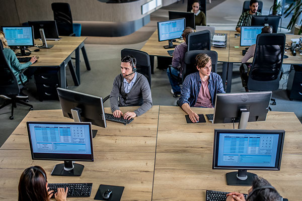 Workers in an office on computers