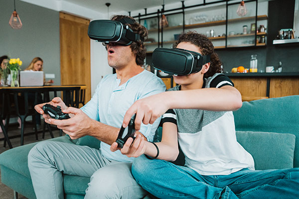 Two people with VR headsets gaming