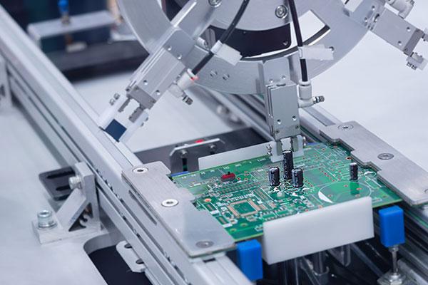 Robot working on circuit board