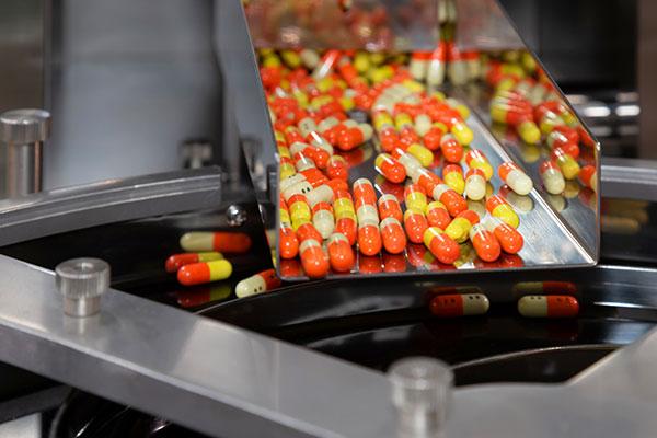 Pills coming down conveyor belt