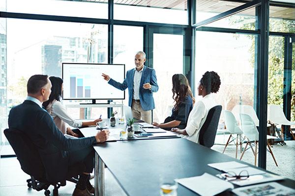 Workers in meeting room