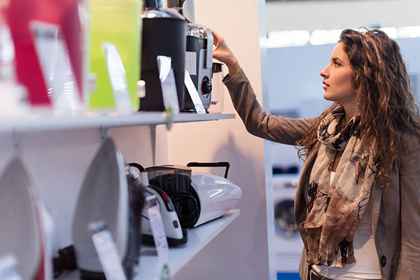 Shopper looks at electronic item