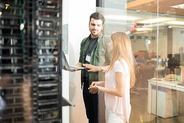 Workers in server room