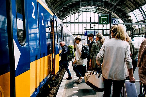 Passengers board a train