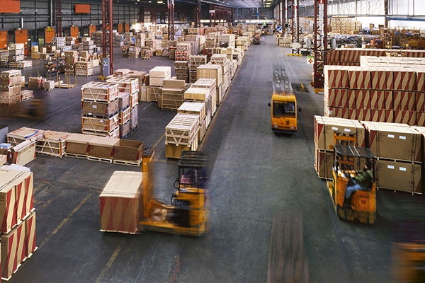 Warehouse with forklift trucks
