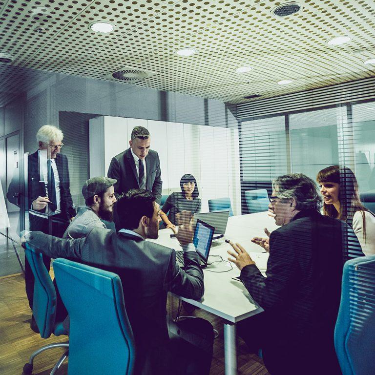 Workers in office meeting