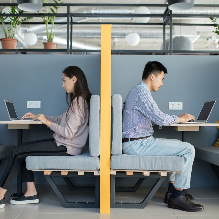 Workers in open plan office space