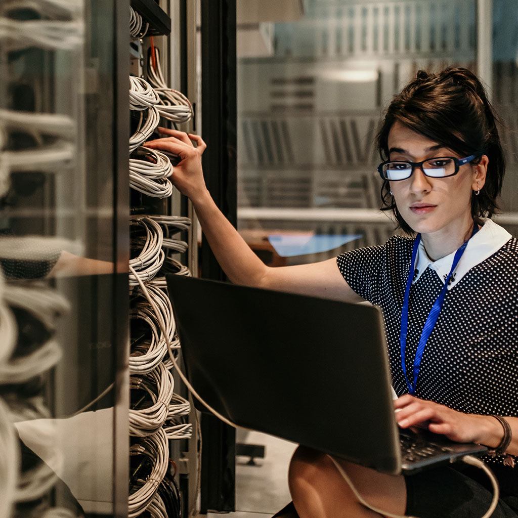 Woman plugging into server