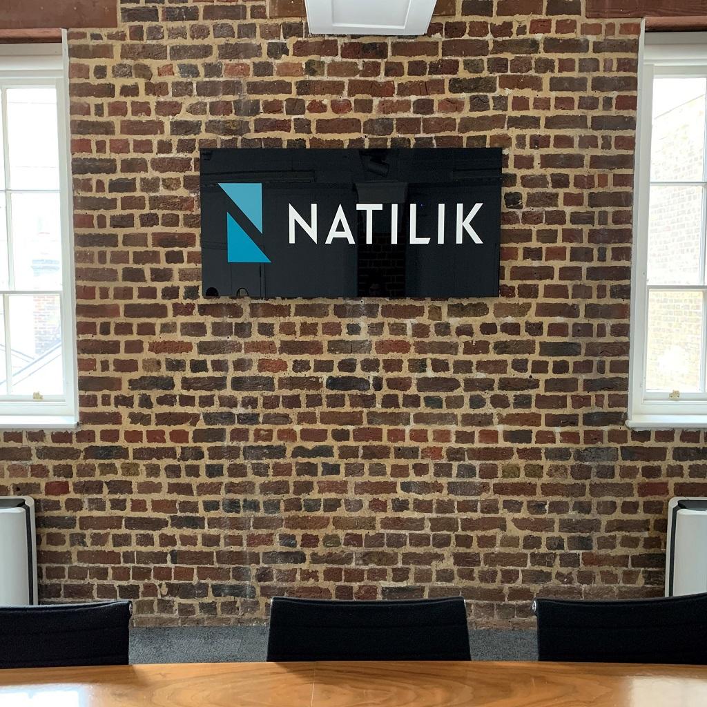 Natilik logo on office wall