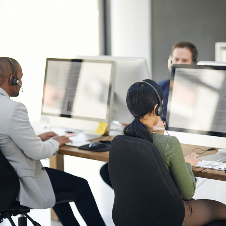 Workings in office with headsets